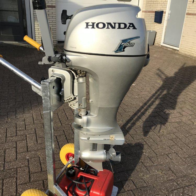 Honda 10pk 4 takt kortstaart zeer nette motor foto: 1